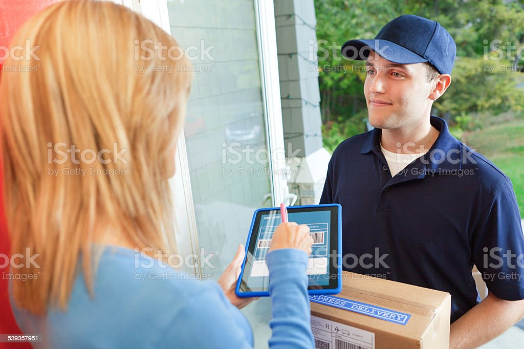 Delivery Person Delivering Package Box Container to Home Customer stock photo