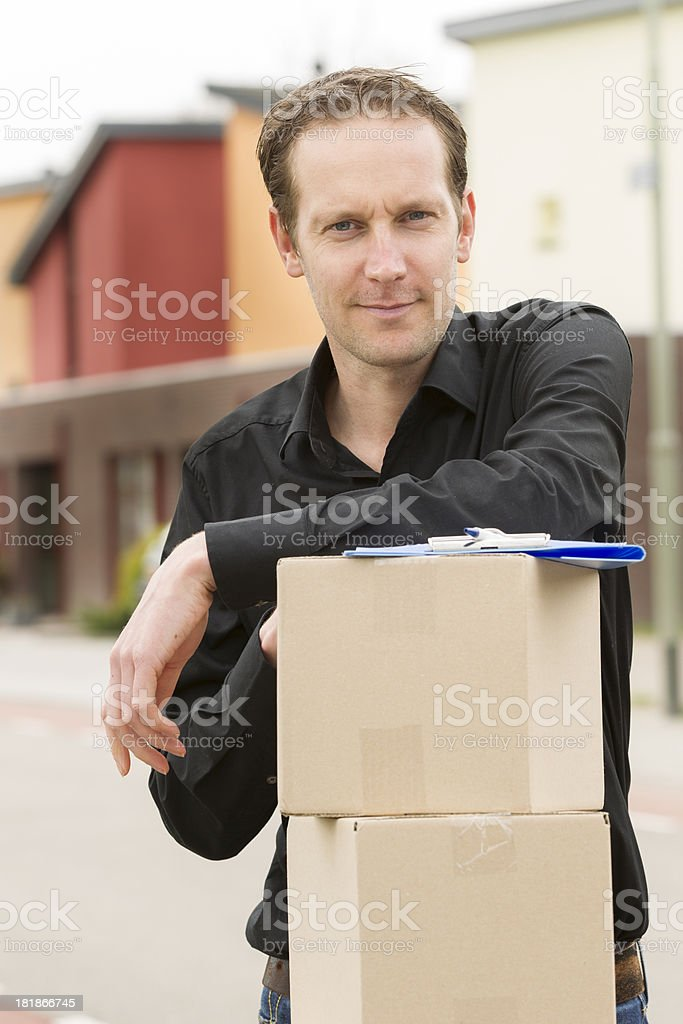 Delivery person delivering package royalty-free stock photo