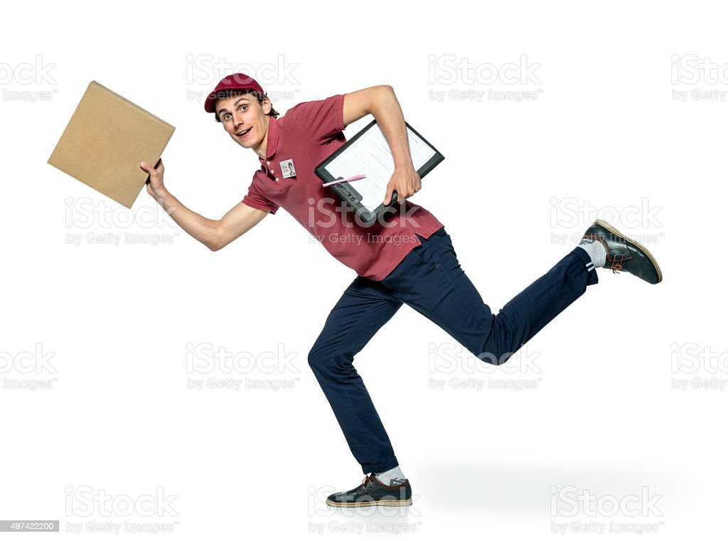 Delivery person delivering packages holding clipboard stock photo