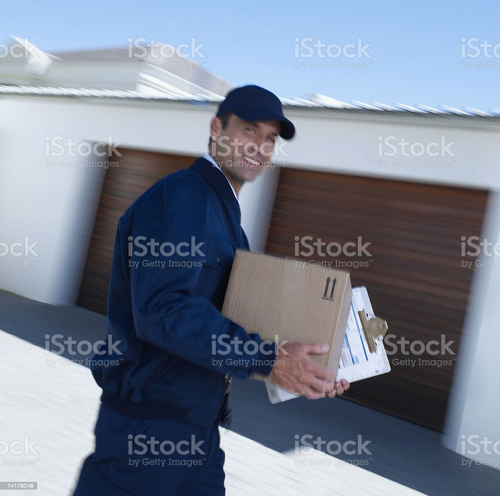 Delivery person with package motion blur royalty-free stock photo