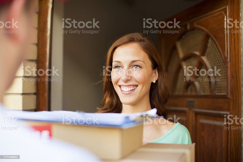 Delivery person with packages. royalty-free stock photo