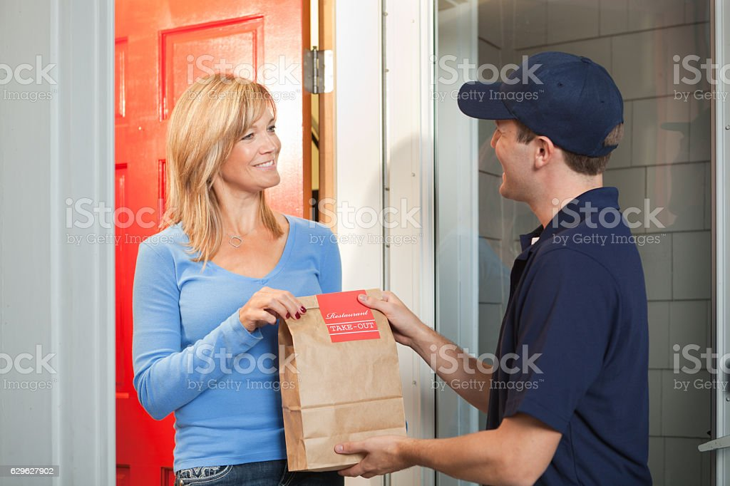 Delivery Service Man Delivering Take-out Food Bag to Customer Door royalty-free stock