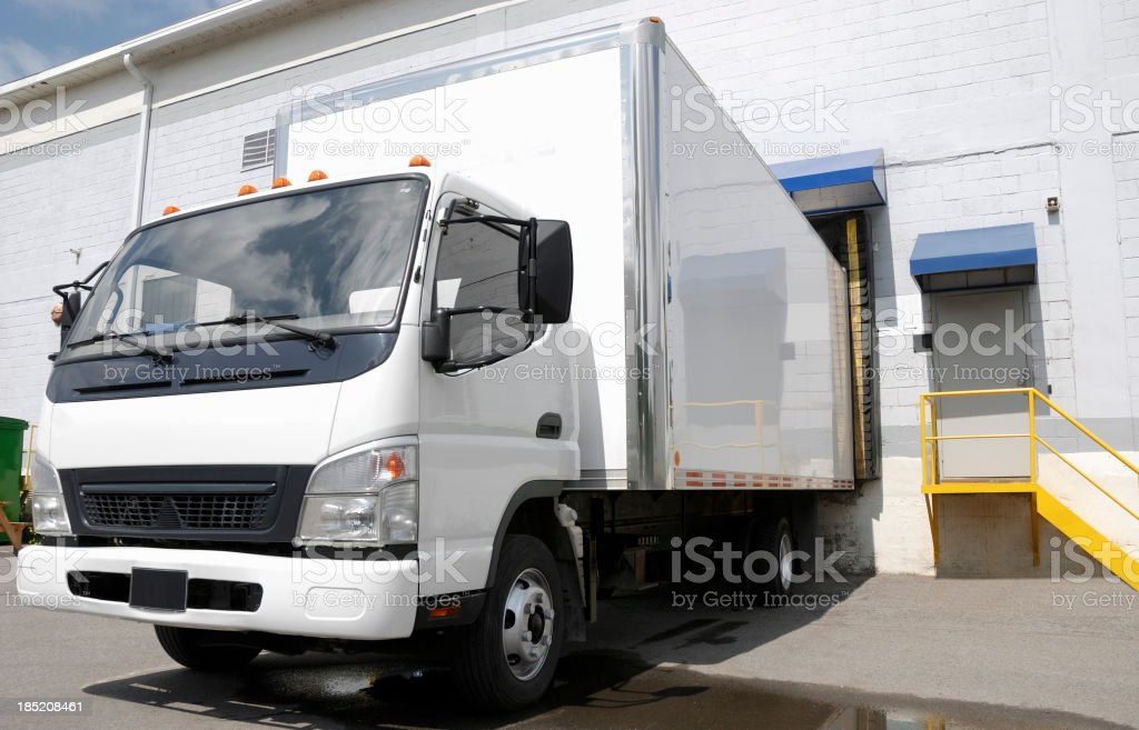 Delivery truck at dock. royalty-free stock photo