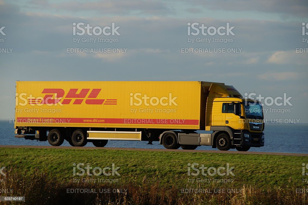 DHL delivery truck at dusk stock photo