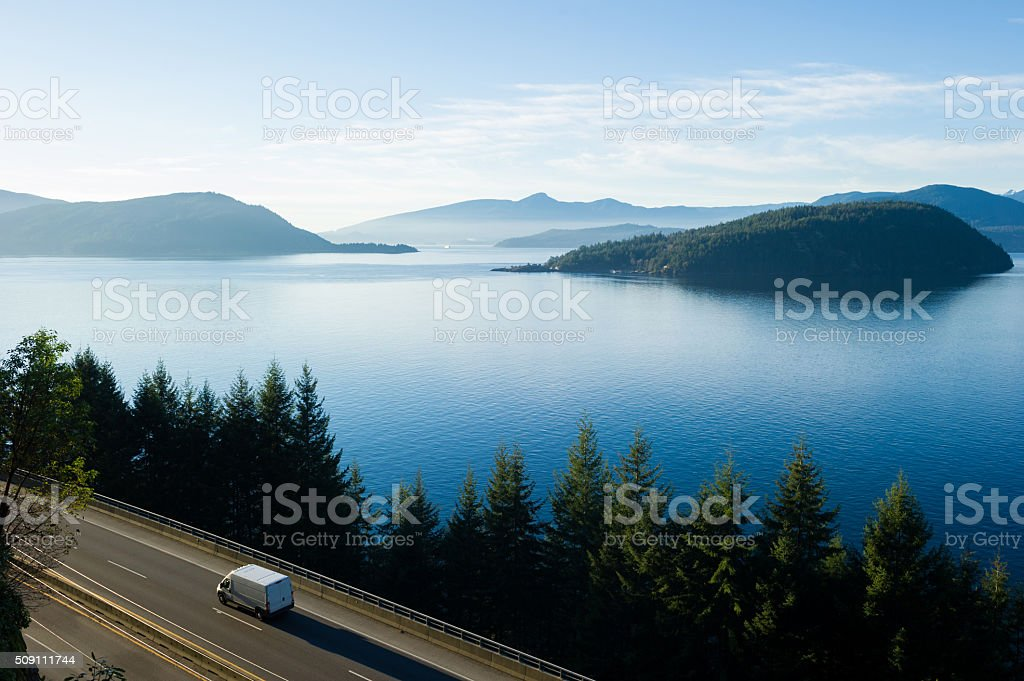 Delivery truck driving along Highway 99, BC, Canada stock photo