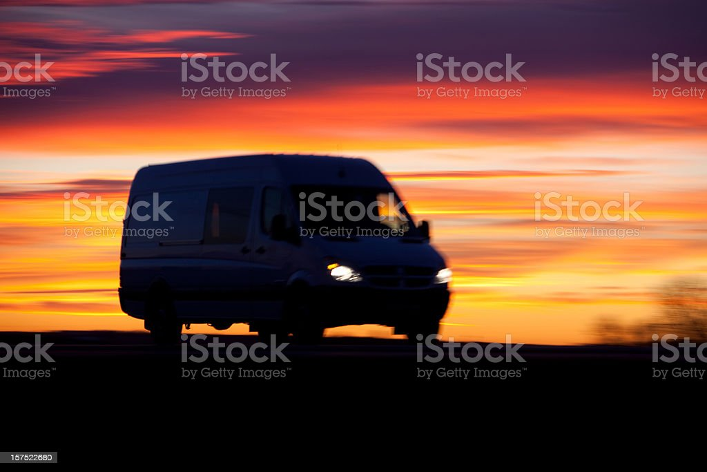 Delivery truck on the highway at sunrise royalty-free stock photo
