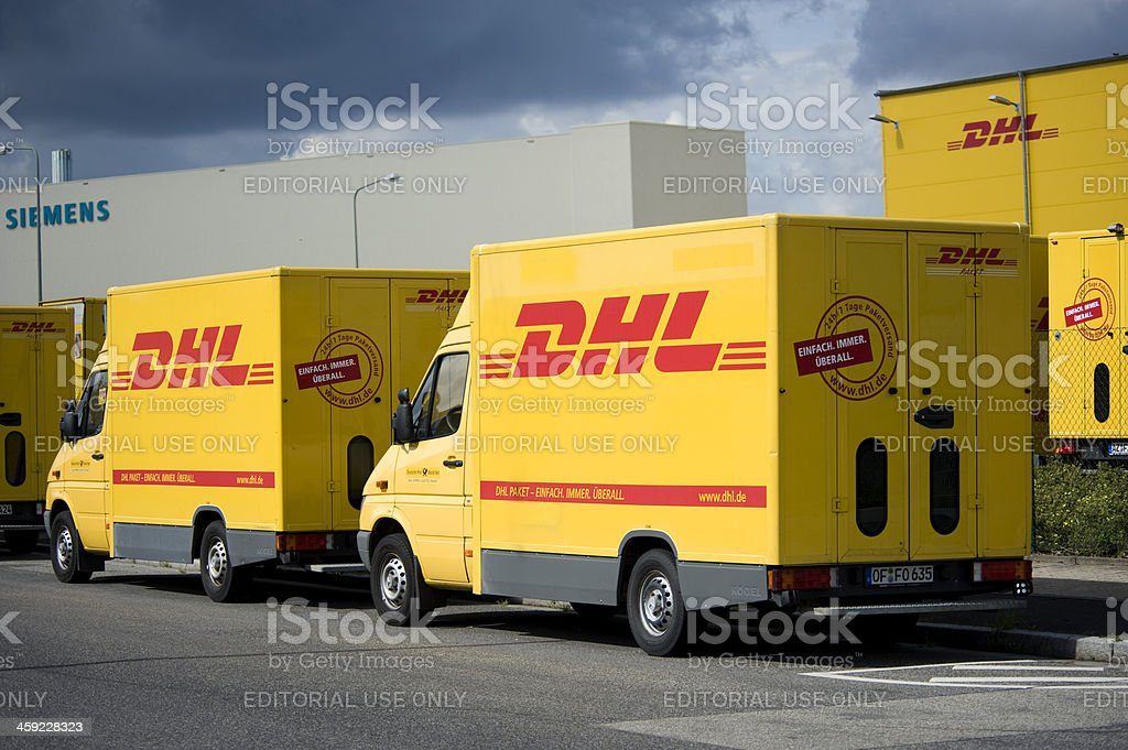 DHL delivery trucks royalty-free stock photo