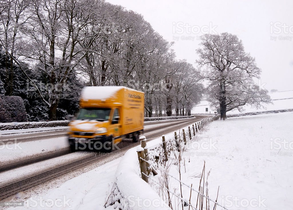 Delivery van in the snow royalty-free stock photo