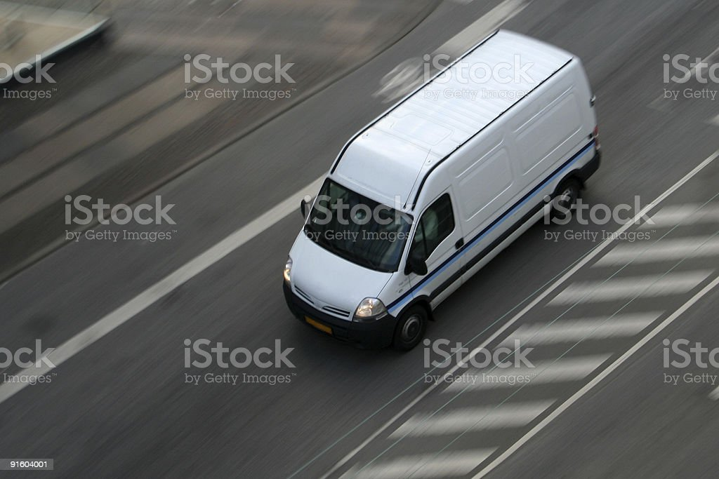 Delivery van moving on road stock photo