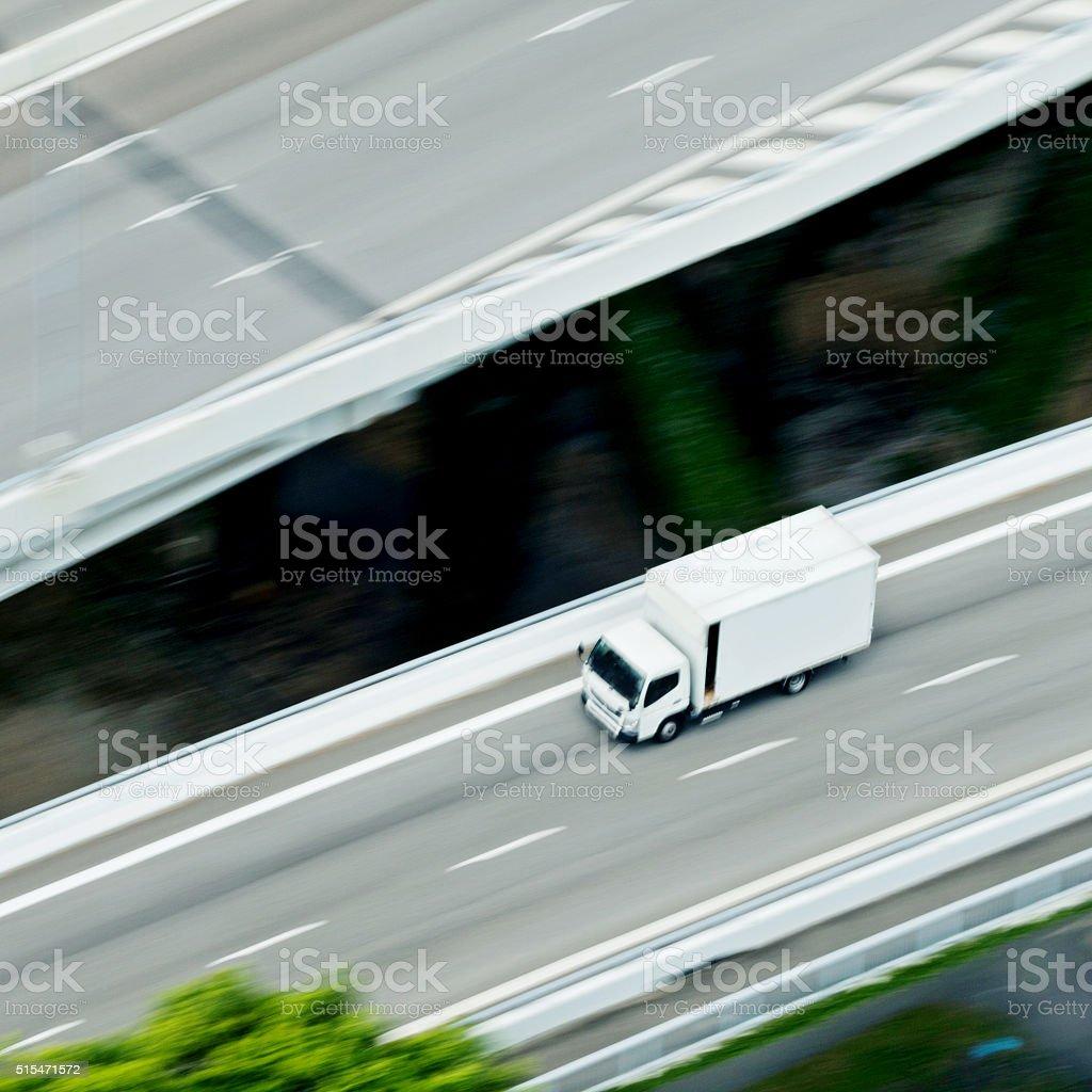 Delivery van speeding on highway stock photo
