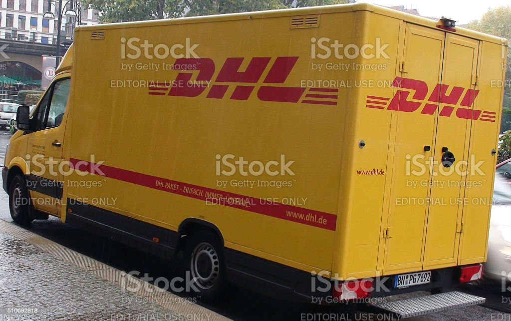 DHL Delivery Van Stopped On The Street For A Delivery.Berlin.Germany stock photo