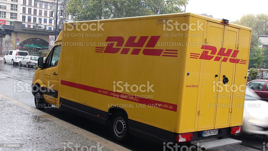 DHL Delivery Van Stopped On The Street For A Delivery.Berlin.Germany.Europe stock photo