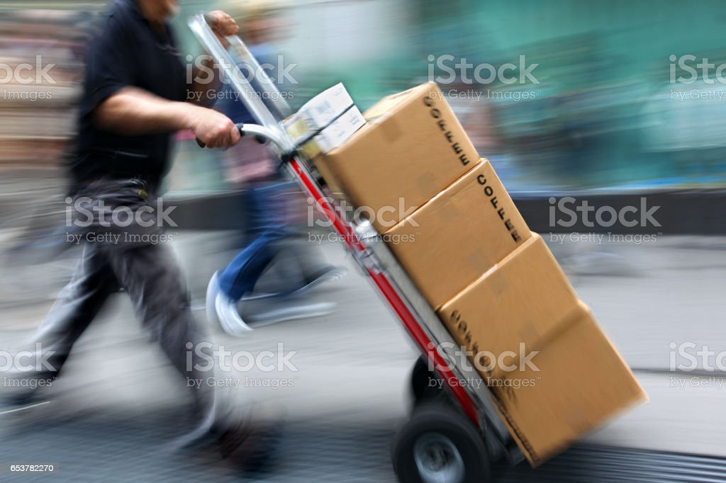 delivery with dolly by hand stock photo