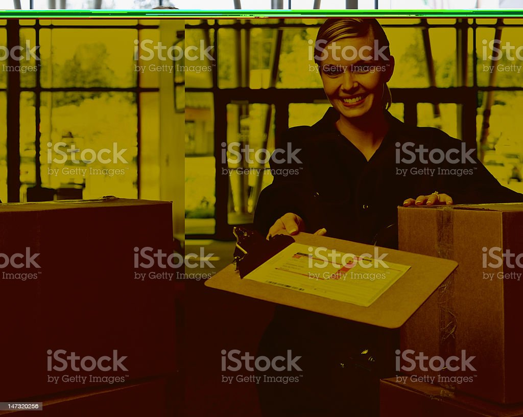 Delivery woman with stack of cardboard boxes royalty-free stock photo