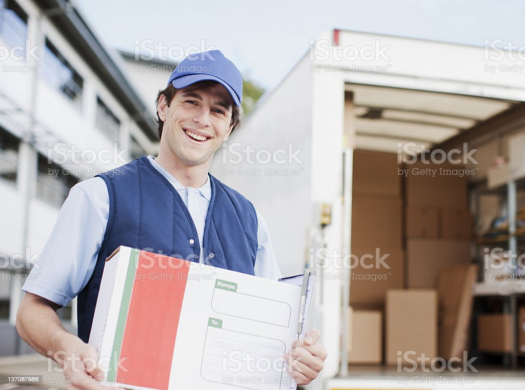 Deliveryman holding package royalty-free stock photo