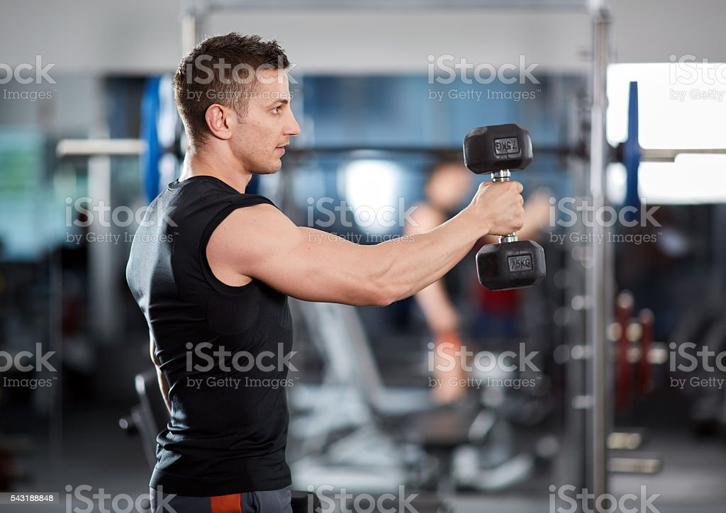 Delts workout with dumbbells stock photo