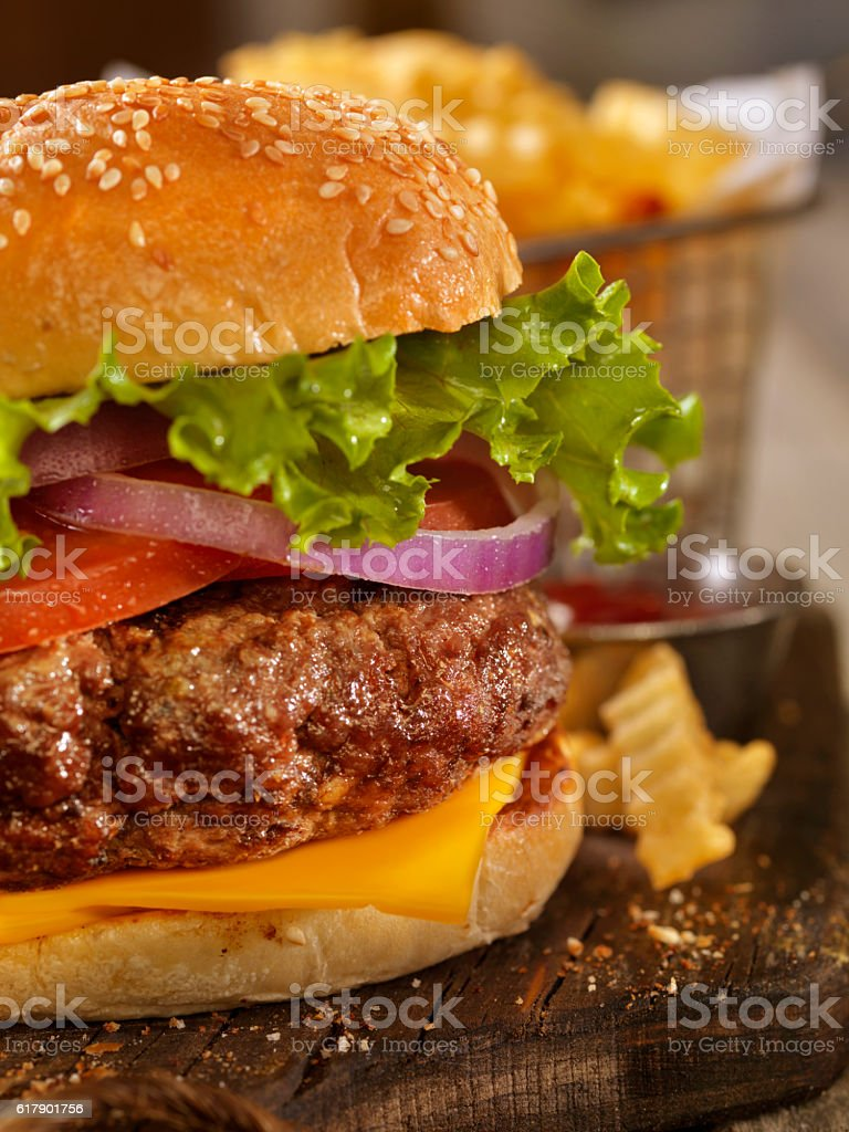 Deluxe Cheeseburger with a Basket of Fries stock photo