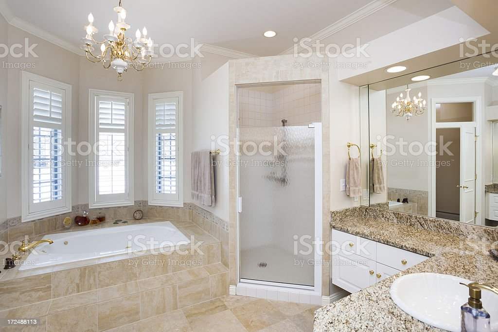 Deluxe Master Bathroom With Tile and Marble Interior royalty-free stock photo