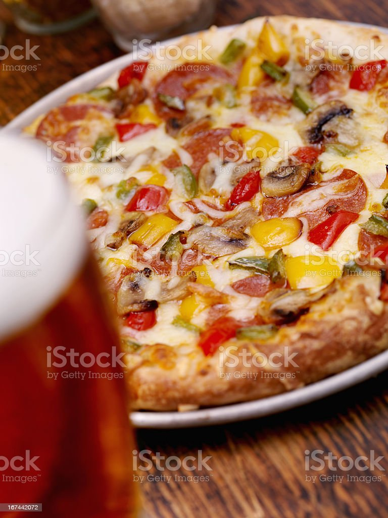 Deluxe Pizza and a Beer royalty-free stock photo