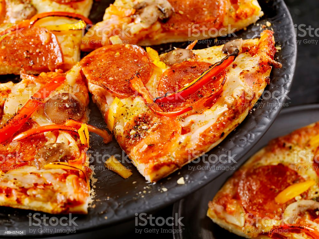 Deluxe Thin Crust Pizza stock photo