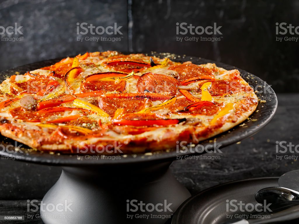 Deluxe Thin Crust Pizza stock photo