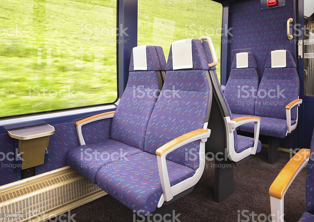Deluxe train seats in motion royalty-free stock photo