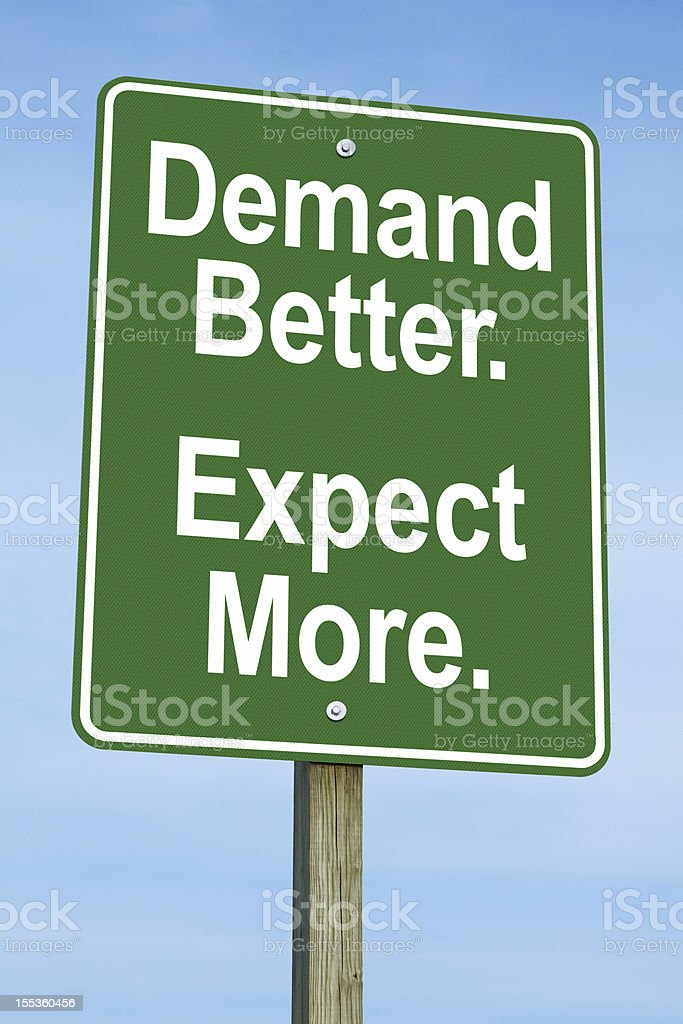 Demand Better, Expect More Road Sign stock photo
