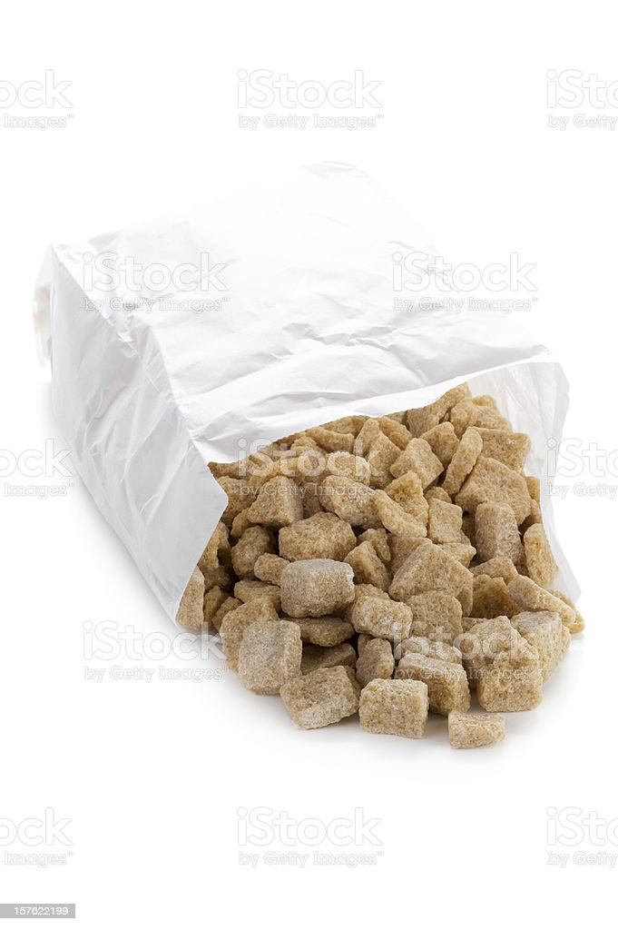 demerara sugar cubes in a paper bag on white royalty-free stock photo