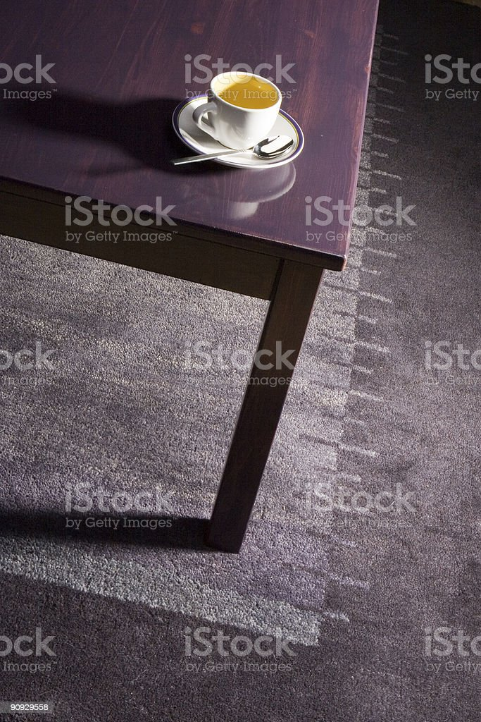 Demitasse on coffee table stock photo