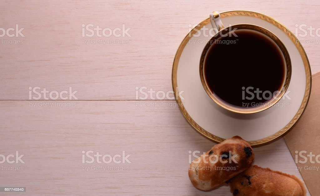 Demitasse with coffee and cookies stock photo
