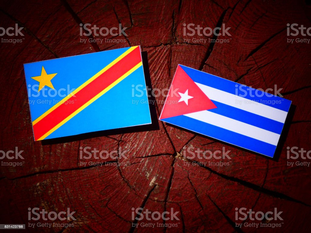 Democratic Republic of the Congo flag with Cuban flag on a tree stump isolated stock photo