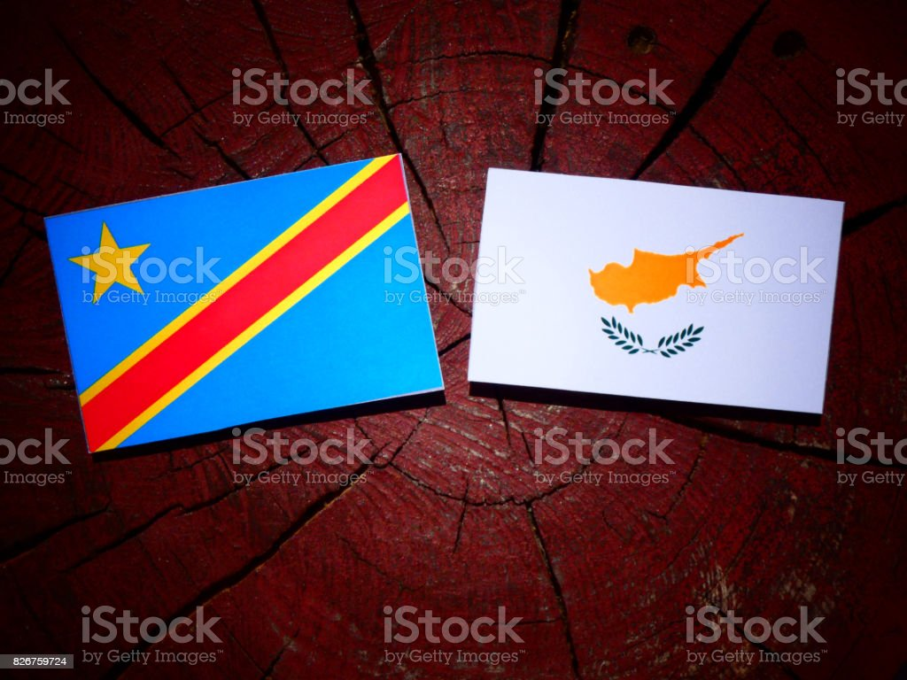 Democratic Republic of the Congo flag with Cypriot flag on a tree stump isolated stock photo