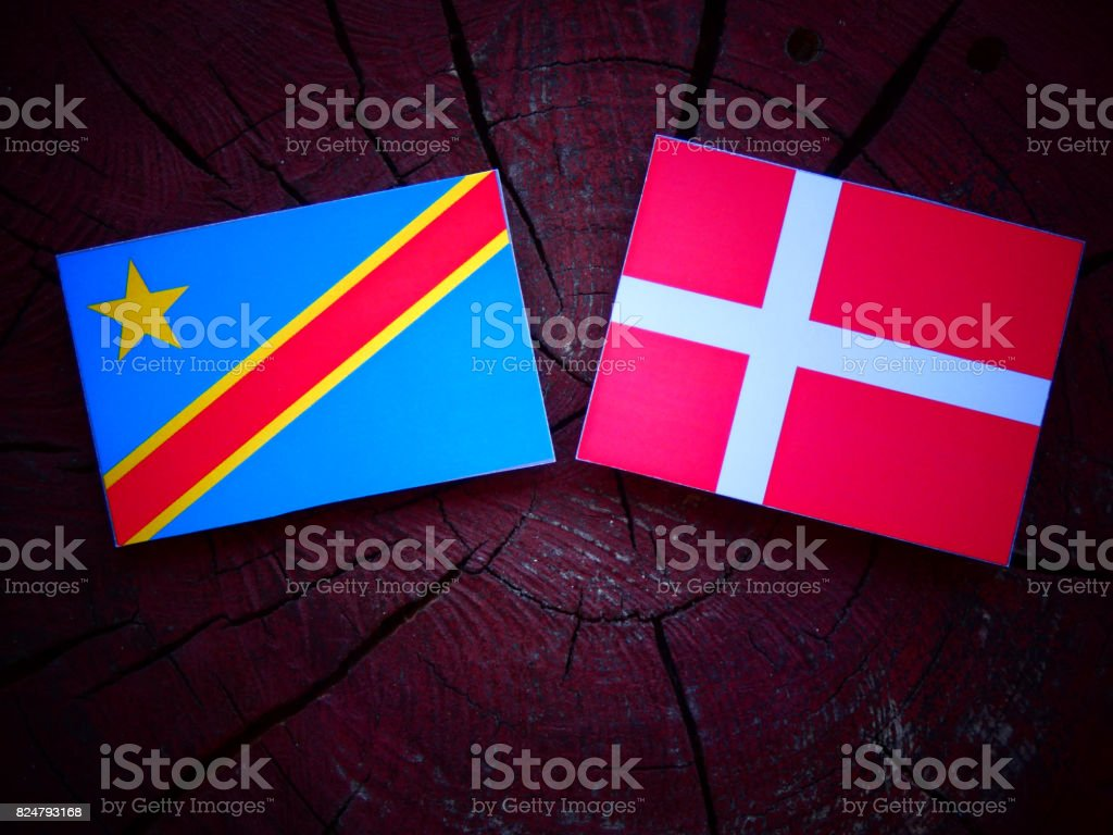 Democratic Republic of the Congo flag with Danish flag on a tree stump isolated stock photo