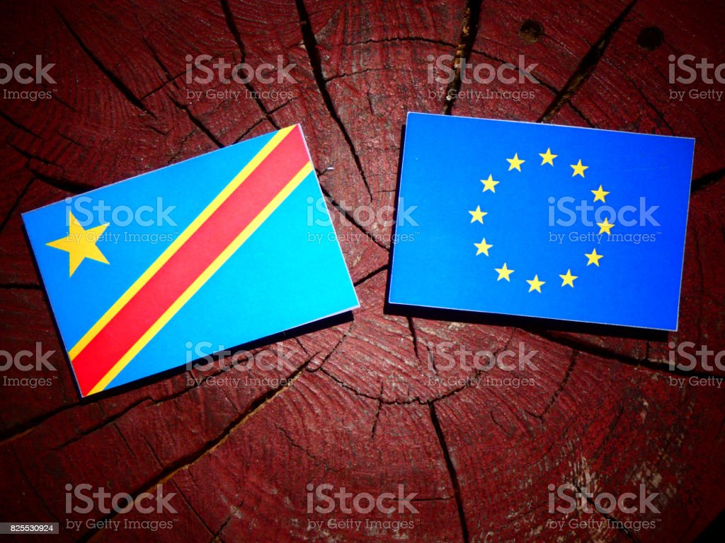 Democratic Republic of the Congo flag with EU flag on a tree stump isolated stock photo