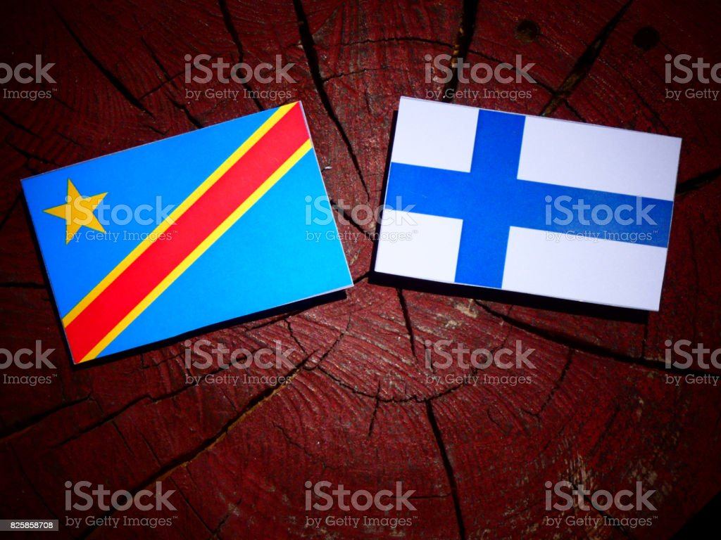 Democratic Republic of the Congo flag with Finnish flag on a tree stump isolated stock photo