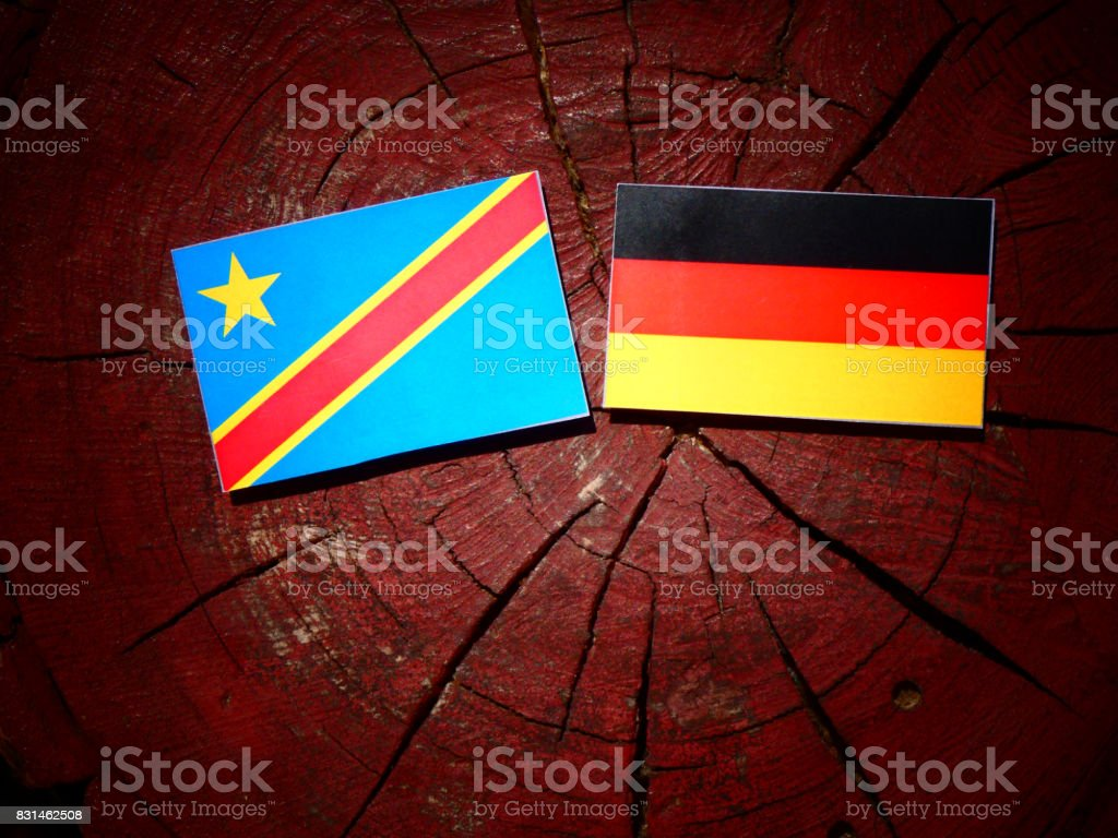 Democratic Republic of the Congo flag with German flag on a tree stump isolated stock photo