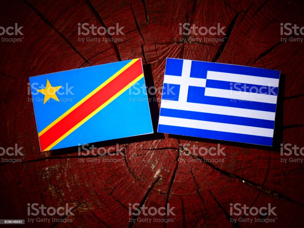Democratic Republic of the Congo flag with Greek flag on a tree stump isolated stock photo