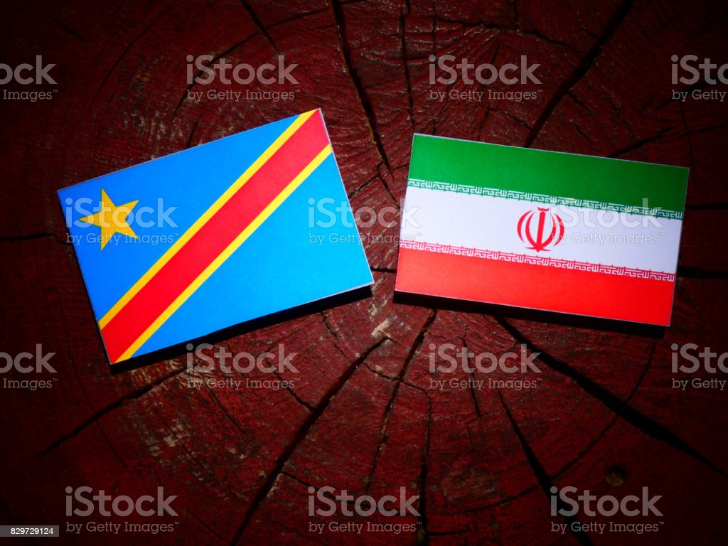 Democratic Republic of the Congo flag with Iranian flag on a tree stump isolated stock photo