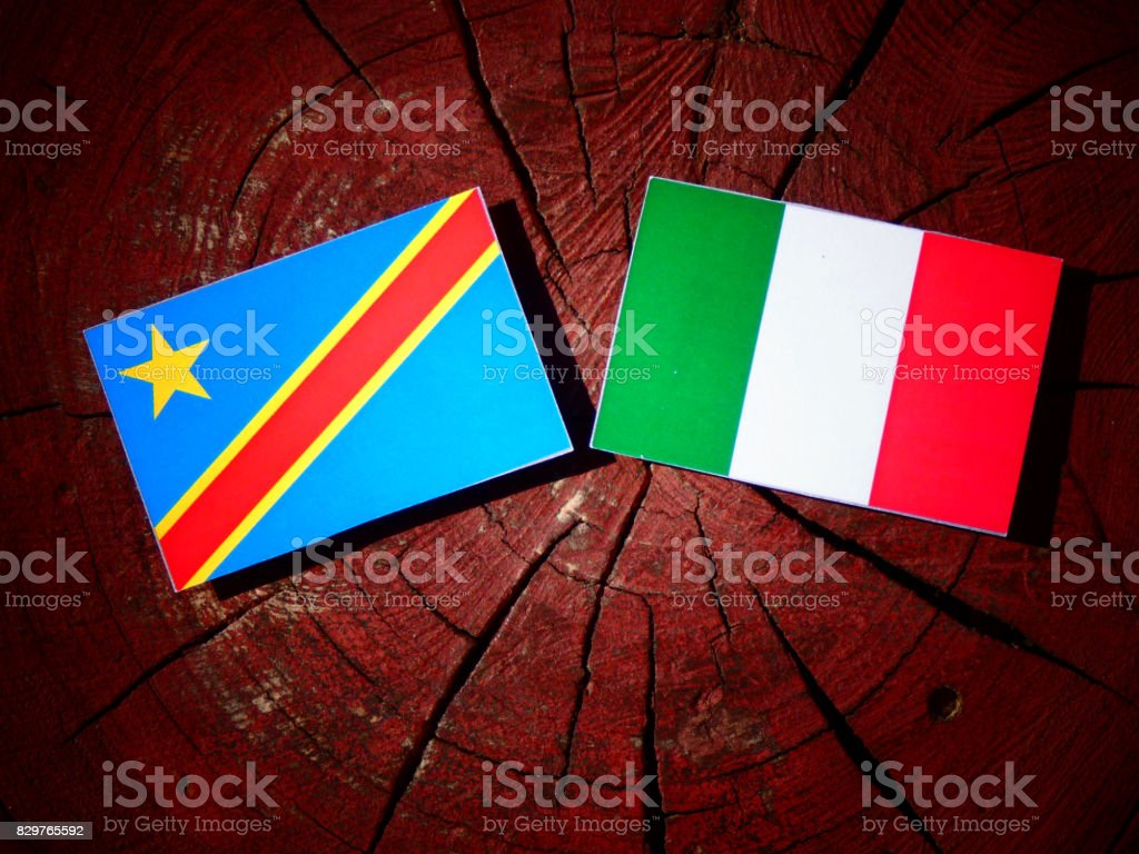 Democratic Republic of the Congo flag with Italian flag on a tree stump isolated stock photo