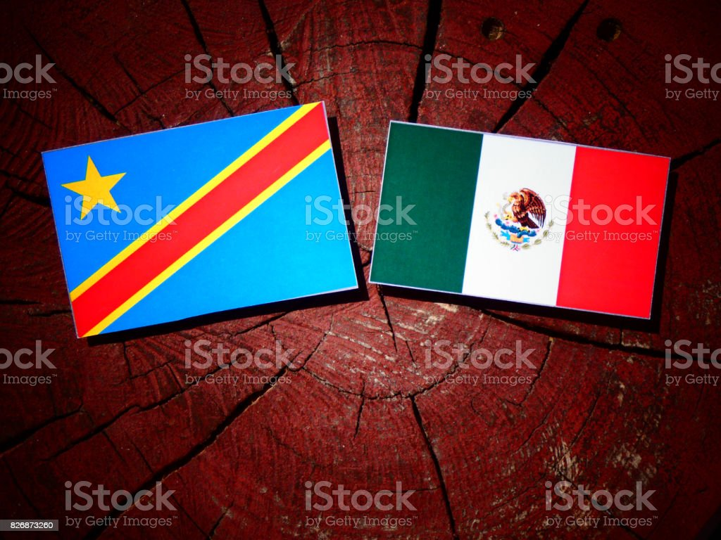 Democratic Republic of the Congo flag with Mexican flag on a tree stump isolated stock photo