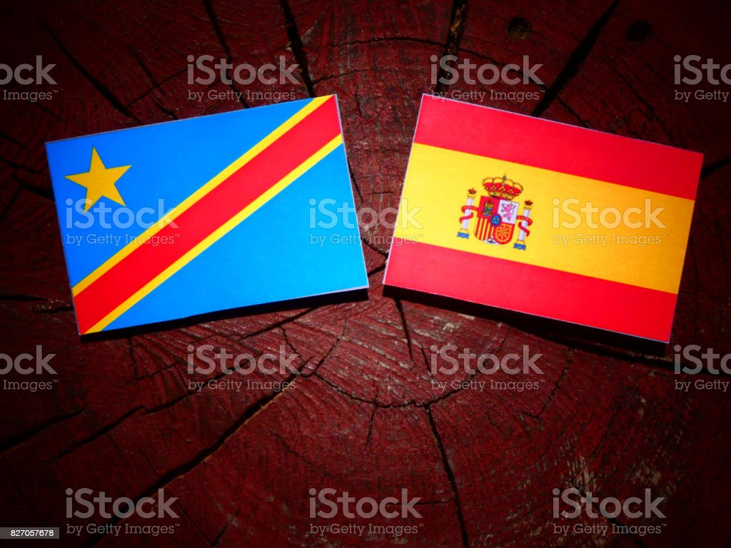 Democratic Republic of the Congo flag with Spanish flag on a tree stump isolated stock photo