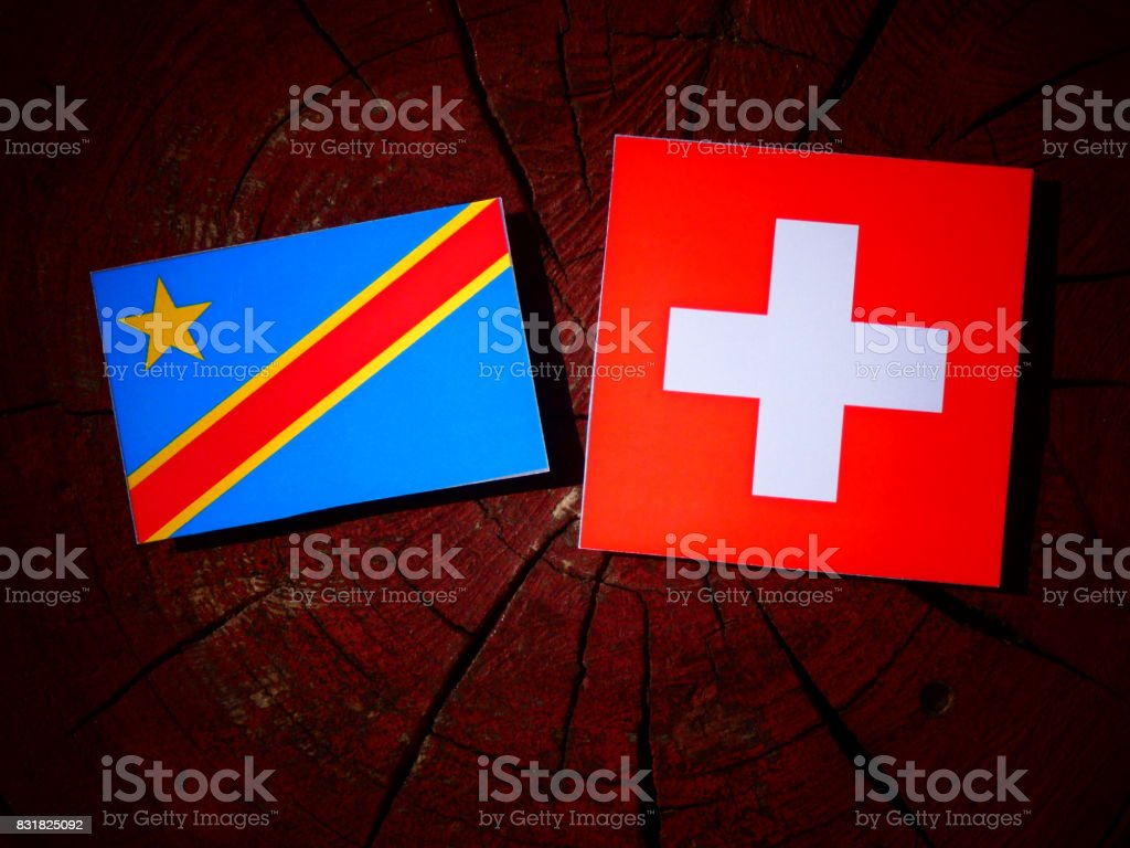 Democratic Republic of the Congo flag with Swiss flag on a tree stump isolated stock photo