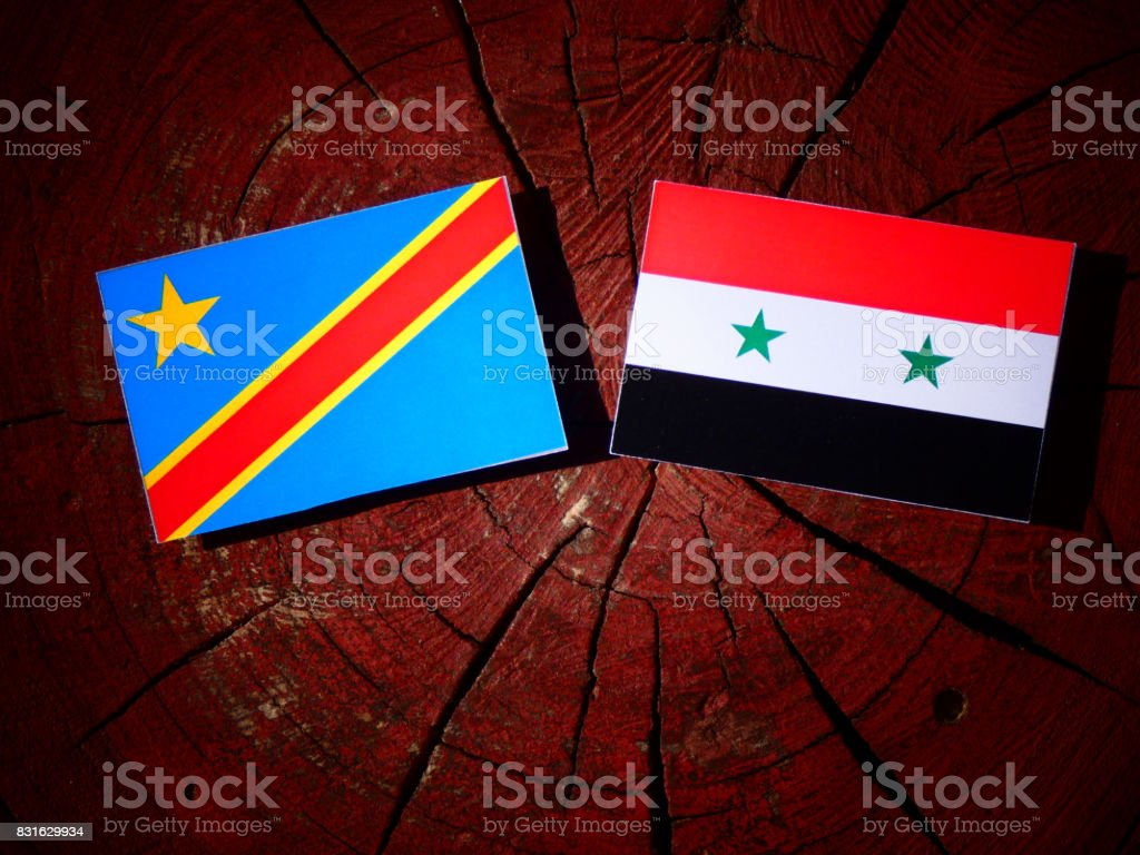 Democratic Republic of the Congo flag with Syrian flag on a tree stump isolated stock photo