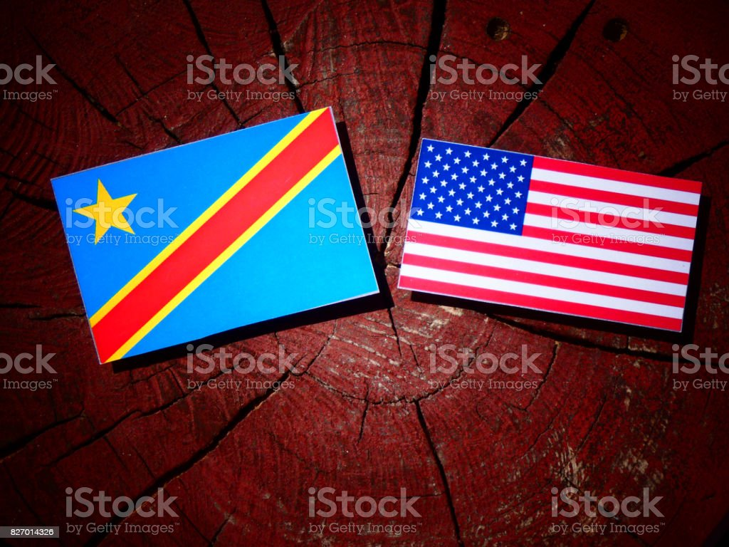 Democratic Republic of the Congo flag with USA flag on a tree stump isolated stock photo