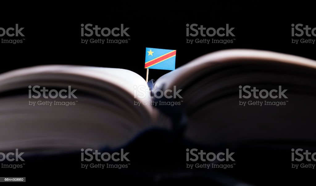 Democtratic Republic of the Congo flag in the middle of the book. Knowledge and education concept. stock photo