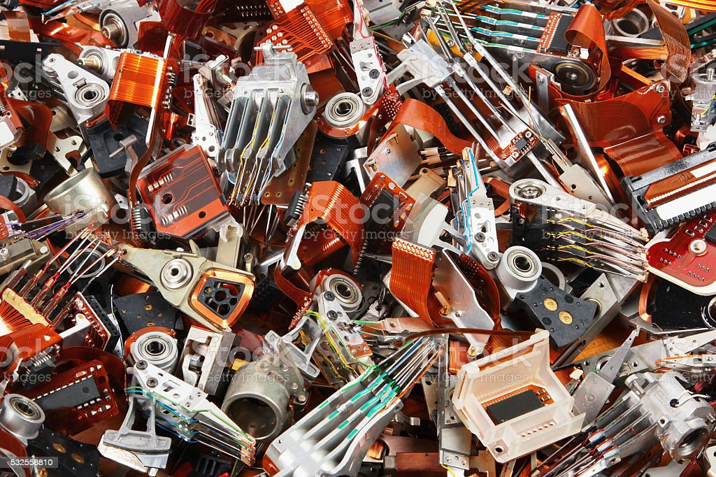 Demolished old hard drive parts as industrial waste background. stock photo
