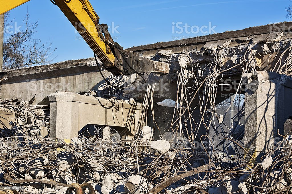 Demolishing - demolition excavator at work stock photo