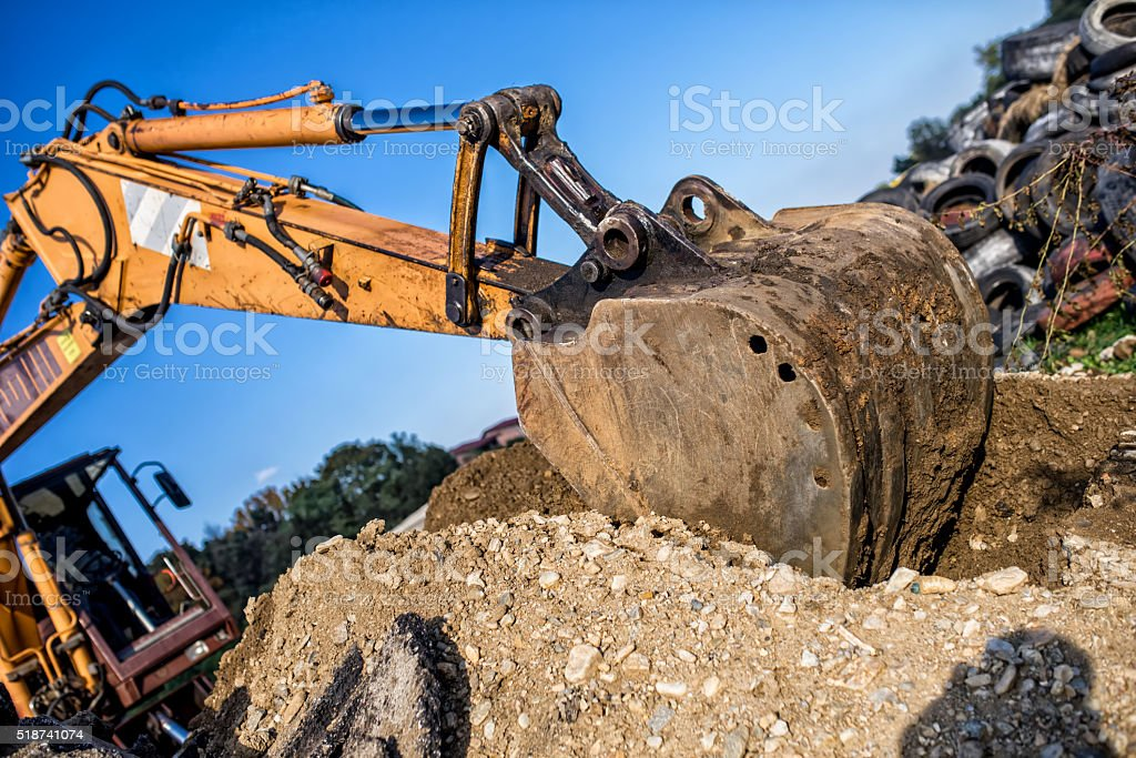 demolishing operations at industrial construction site. stock photo