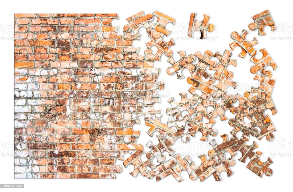 Demolition of an old brick wall - concept image in puzzle shape stock photo