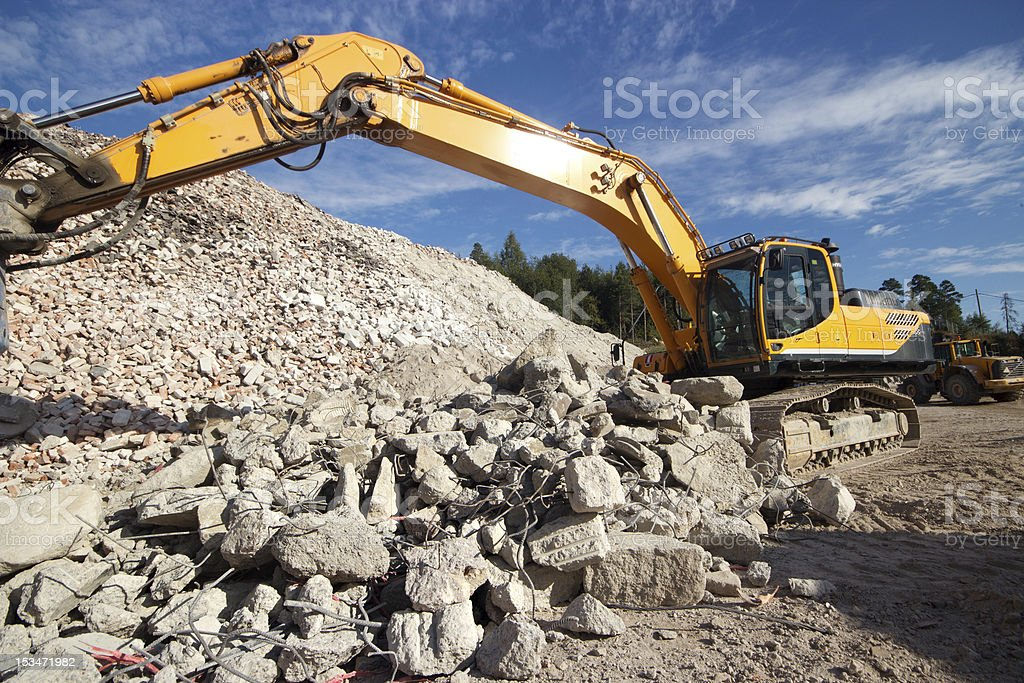 Demolition waste and excavator royalty-free stock photo